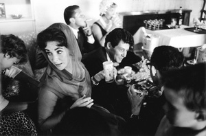 Elizabeth Taylor and Eddie Fisher seated with guests on their wedding day1959 / Las Vegas, Nevada © 1978 Bob Willoughby - Image 0712_5163