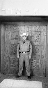 A guard standing in front of the Synagogue door where Elizabeth Taylor married Eddie Fisher1959 / Las Vegas, Nevada © 1978 Bob Willoughby - Image 0712_5175
