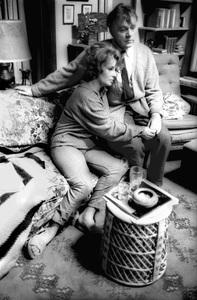 "Elizabeth Taylor and Richard Burton resting on the set of ""Who"