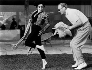 Elizabeth Taylor and Michael Wilding on a Sunday morning at home, Wildings, both bullfight fans, burlesque charge of the bull.  Liz bought matador