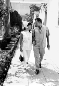 "Elizabeth Taylor and Richard Burton at Warner Brothers Studio after a day of shooting the film ""Who"