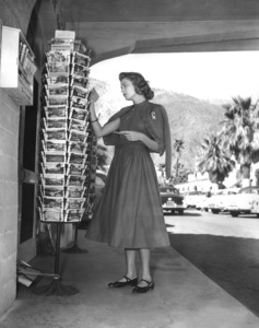 Grace Kelly in Palm Springs, CA shopping for postcards, c. 1954. - Image 0724_0124