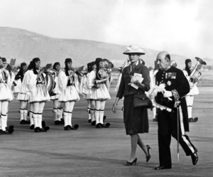 Grace Kelly with the band of the Greek Royal Evzones playing in the background, escorted by the Grand Marshal of the Court of Levidis, 1962. - Image 0724_0256