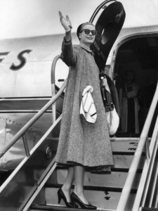 Grace Kelly waving farewell before boarding an American Airlines plane to N.Y., 1956.**I.V. - Image 0724_0347