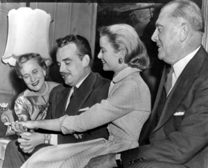 Grace Kelly with Prince Rainier showing off her ring to parents Mr. & Mrs. Kelly, 1956.**I.V. - Image 0724_0363