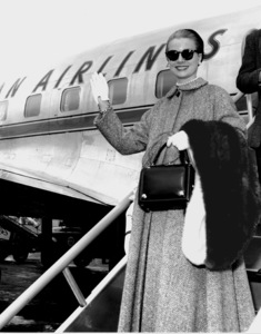 Grace Kelly waving farewell beforeboarding an American Airlines planeto New York, 1956.  **I.V. - Image 0724_0399