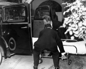 The sheet-covered body of actress Lupe Velez is wheeled from her luxurious movie capital home, where she committed suicide and left a note blaming her action on a broken love affair12-15-1944 - Image 0725_0018