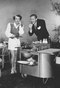 "Joan Crawford at homewith co-star David Brian of "" The Damned Don"