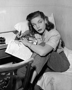 """Lauren Bacall in her portable dressing room on the set of """"To Have and Have Not,"""" was busy at the business of autographing a photograph for a freind1944 Warner BrothersPhoto by Lloyd MacLean - Image 0730_0084"""