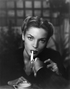 "Lauren Bacall in ""Dark Passage"" (Humphrey Bogart lights cigarette)1947Photo by Mac Julian - Image 0730_0249"