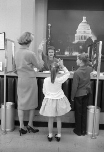 Lauren Bacall, daughter Leslie Bogart and son Stephen H. Bogart getting their passports at the Los Angeles US Passport Office1958© 1978 Bob Willoughby - Image 0730_0551