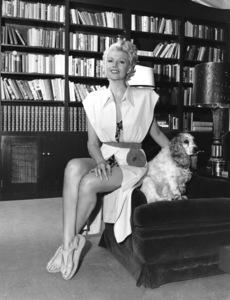 Rita Hayworth with her cocker spaniel, Poolkesin her Santa Monica homecirca 1948Photo by Coburn**I.V. - Image 0742_2044