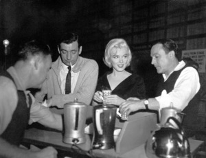 "Marilyn Monroe withYves Montand and Gene Kelly on theset of ""Let"