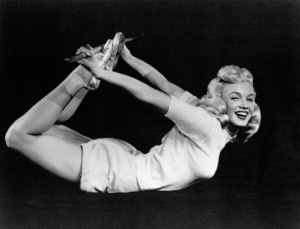 """Marilyn Monroe taken during the filming of""""Ladies Of The Chorus (1948), ColumbiaPictures took photos of the young starlet exercisingfor a publicity piece on """"How To Exercise.""""**R.C. - Image 0758_0099"""