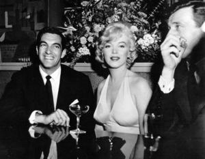 "Marilyn Monroe with Frankie Vaughan andYves Montand at a party for ""Let"
