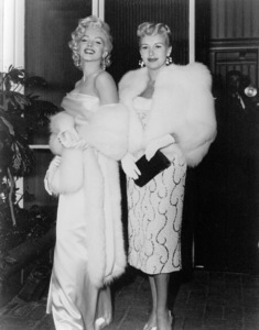 Marilyn Monroe and Betty Grablearriving at Walter Winchell