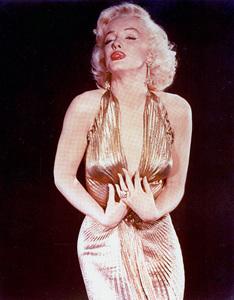 "Marilyn Monroe in a sheer gold lameTravilla gown in which she appearedbriefly in ""Gentlemen Prefer Blondes,""1953. Photo by Gene Kornman - Image 0758_0407"