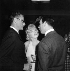"Arthur Miller, Marilyn Monroe, Yves Montandat a party for ""Let"