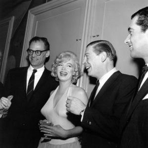 "Arthur Miller, Marilyn Monroe, Milton Berleat a party for ""Let"