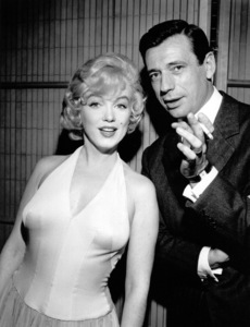 """Marilyn Monroe and Yves Montandat a party for """"Let"""