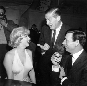 "Marilyn Monroe, Milton Berle, Yves Montandat a party for ""Let"