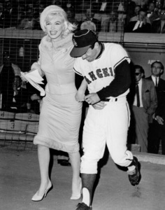 Marilyn Monroe runs onto Chavez Ravineaccompanied by Angels outfielder Albie Pearson.She made a plea for donations to the musculardystrophy fund in pre-game ceremonies. 6/1/62. - Image 0758_0541