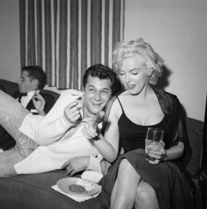 Marilyn Monroe with Tony Curtis celebrating Sammy Davis Jr.