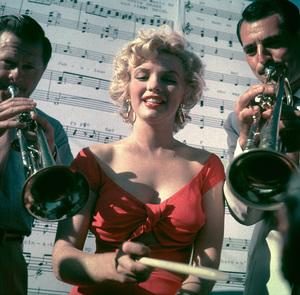"Marilyn Monroe with orchestra leaderRay Anthony at a Hollywood Party in whichRay Anthony unveiled the musical homage""Marilyn"" August 1952. © 1978 Bob Willoughby - Image 0758_0651"