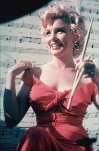 """Marilyn Monroe at a Hollywood Party in whichRay Anthony unveiled the musical homage""""Marilyn"""" August 1952. © 1978 Bob Willoughby - Image 0758_0652"""