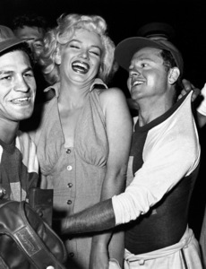 """Marilyn Monroe with Art Aragon &Mickey Rooney at a Hollywood EntertainersBaseball Game """"Out Of This World Series""""at Gilmore Field in Hollywood, March 17, 1952. © 1978 Gerald Smith - Image 0758_0774"""