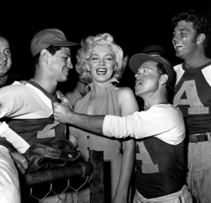 """Marilyn Monroe with Art Aragon, Mickey Rooney& Dale Robertson at a Hollywood EntertainersBaseball Game """"Out Of This World Series""""at Gilmore Field in Hollywood, March 17, 1952. © 1978 Gerald Smith - Image 0758_0778"""