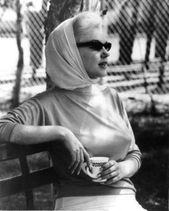 Marilyn Monroe sits in the Florida sun watching Joe DiMaggio in his new role as batting coach for the New York Yankees, 1961. - Image 0758_0784