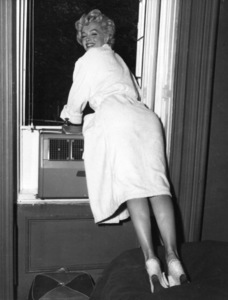 """Marilyn Monroe greeting fans gathere outside ofthe window in NY during filming of """"The SevenYear Itch,"""" 1954. - Image 0758_0791"""