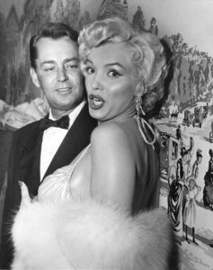 Marilyn Monroe with Alan Ladd after receivingactor & actress awards at the Photoplay GoldMetal Awards dinner, 1954. - Image 0758_0794