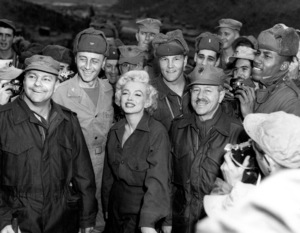 Marilyn Monroe with Gen. R. Hogaldoomand Col. W.K. Jones after a show given in Koreafor more than 10,000  Marines, 1954. - Image 0758_0800