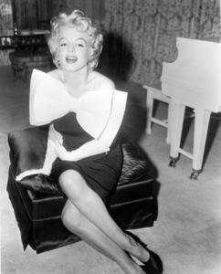 """Marilyn Monroe in her Fifty-seventhStreet apartment, models the new """"Sack""""fashion, all the rage that season.c. 1958. - Image 0758_0814"""