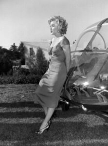 """Marilyn Monroe at a Hollywood Partyin which Ray Anthony unveiled the musicalhomage """"Marilyn"""" August 1952.  - Image 0758_0842"""