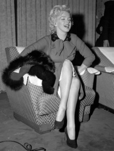 Marilyn Monroe, arriving in Japan for a honeymoon trip with Joe DiMaggio, talks with the press, c. 1954. **I.V. - Image 0758_0849