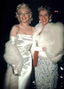 Marilyn Monroe and Betty Grable arriving at Walter Winchell