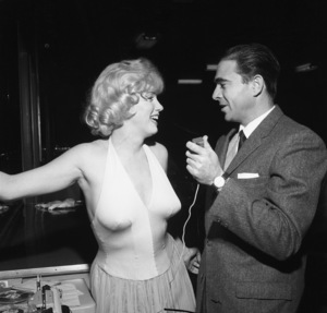 """Marilyn Monroe and Army Archerd at a party for """"Let"""