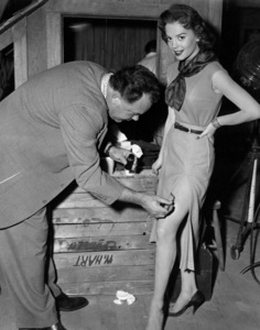 """Natalie Wood with makeup artist adds bruisesfor upcoming scene in """"A Cry In The Night,""""1956. - Image 0764_0155"""