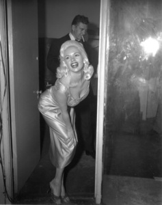 Jayne Mansfield with  husband Mickey Hargitay in the backgroundCirca 1958 - Image 0774_0575