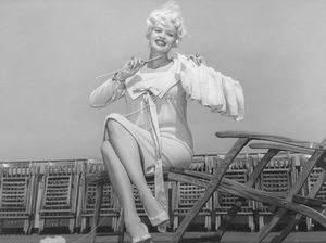 Jayne Mansfieldpreparing for the birth of son Miklos Hargitay by knitting a baby blanket aboard the Queen Elizabeth July 29, 1958 - Image 0774_0638