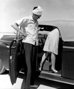James Stewart helping a woman1938Copyright John Swope Trust / MPTV - Image 0802_2153