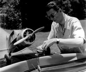 James Stewartstrapping model airplane to car, 1938.Copyright John Swope Trust / MPTV - Image 0802_2158