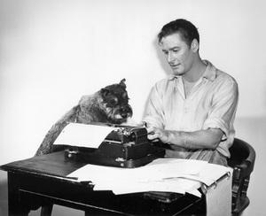 "Errol Flynn and dog, ""Moody""circa 1945Photo by Pat Clark - Image 0803_0009"