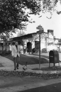 Cary Grant walking his Siamese cat at the corner of Swall Drive and Charleville Boulevard in Beverly Hills, California1960© 1978 Sanford Roth / A.M.P.A.S. - Image 0807_2005