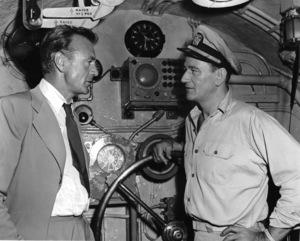 "Gary Cooper visiting John Wayne on the set of ""Operation Pacific,"" Warner Bros. 1950 Photo by Morgan - Image 0809_0068"
