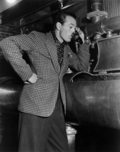 Gary Cooper testing the first batch of real honest-to-goodness beer to come through the vats at the Los Angeles Brewing Companycirca 1935 - Image 0809_0271