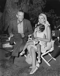 """Fred Astaire with Princess Grace Kelly of Monaco and her daughter Stephanie on the set of """"Finian"""
